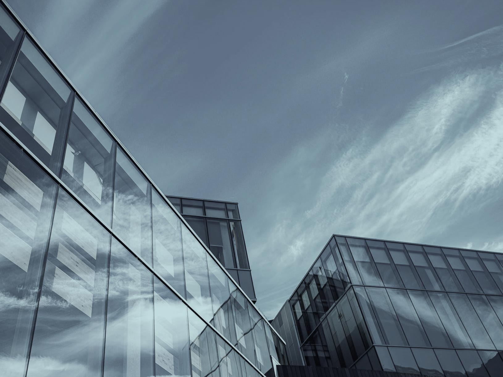 Decorative image of a sky showing the tops of modern office buildings